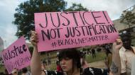 ائتمانات/صور : Protesters hold up signs during a demonstration against police brutality in Charlotte, North Carolina, on September 21, 2016