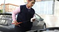 credits/photos : Nisrine Akoubeh checks the oil level of her taxi in Amman on 6 December 2016