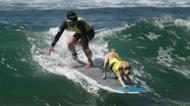 credits/photos : A surf dog competes in the tandem event during the 8th annual Surf City Surf Dog event at Huntington Beach, California