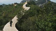 credits/photos : A villager walks on a paved-over section of the Great Wall of China at Suizhong, in the northeast Liaoning province on September 21, 2016