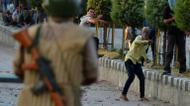 credits/photos : Kashmiri protesters throw stones after Indian paramilitary troops fired tear gas during clashes in Srinagar on July 21,2016