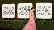 credits/photos : Felicity Jones arrives at the 74th annual Golden Globe Awards, January 8, 2017, at the Beverly Hilton Hotel in Beverly Hills, California