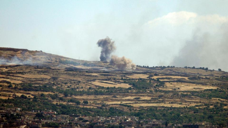 A picture taken from the Golan Heights shows smoke rising from the Syrian Druze village of Hader, on June 16, 2015