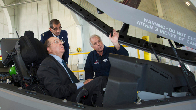 Israeli Defense Minister Moshe Yaalon (L) in the cockpit of an F-35