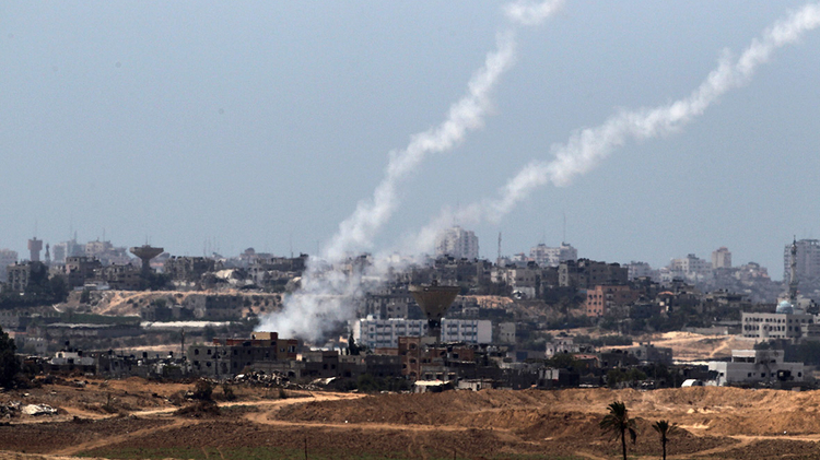 A picture taken from the Israeli side of the border shows rockets being fired by Palestinian militants from the Gaza strip into Israel