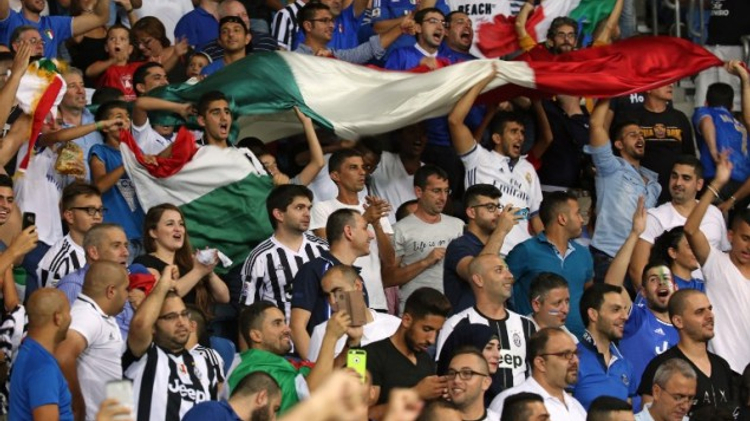 Italian fans celebrate after Italy scored their third goal during the World Cup 2018 qualifying football match between Israel and Italy at Sammy Ofer Stadium in Haifa on September 5, 2016.