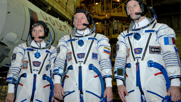 In the Integration Facility at the Baikonur Cosmodrome in Kazakhstan, Expedition 50-51 crew members Peggy Whitson of NASA (left), Oleg Novitskiy of the Russian Federal Space Agency (Roscosmos, center) and Thomas Pesquet of the European Space Agency (right
