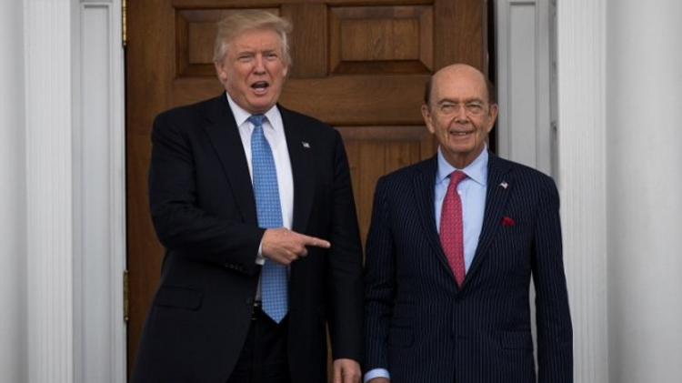 President-elect Donald Trump and investor Wilbur Ross pose for a photo following their meeting at Trump International Golf Club, November 20, 2016 in Bedminster Township, New Jersey.