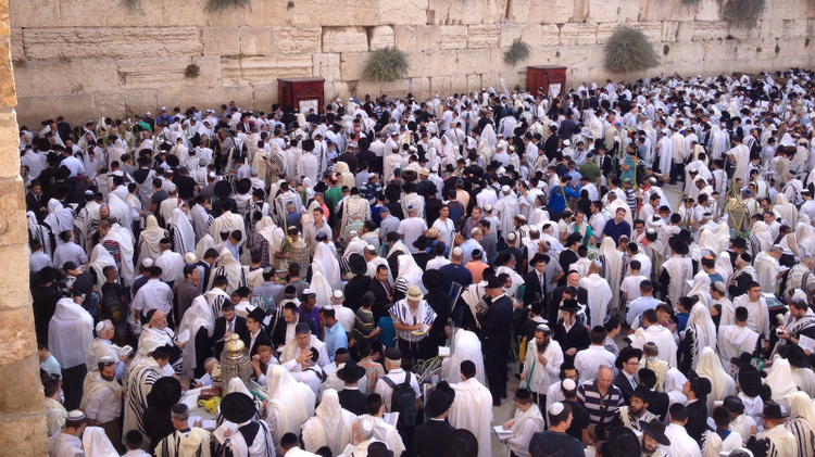 Tens of thousands of Jewish worshippers massed at Jerusalem's Western Wall as part of celebrations for the Sukkot holiday