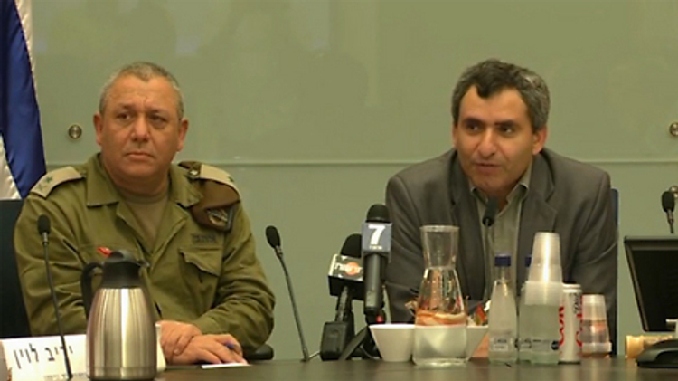 Chairman of the Knesset Foreign Affairs and Defense Committee, MK Ze'ev Elkin (right) with senior military official during Gaza operation