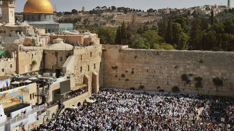 Jewish worshippers draped in prayer shawls performing the annual Priestly Blessing during Sukkot at the Western Wall in the Old City of Jerusalem, Israel, Sept. 30, 2015.