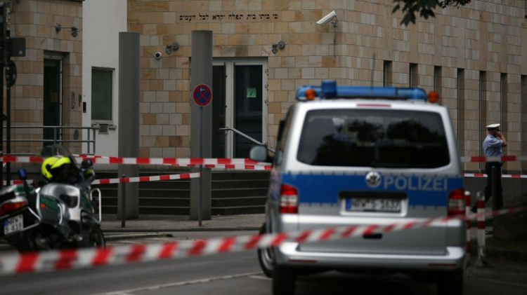 Policemen stand outside a synagogue in Wuppertal, western Germany, where three men attempted an arson attack.