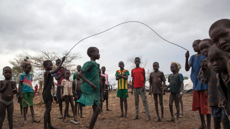 Children jump rope in the Kule refugee camp near the Pagak border entry in the Gambela Region of Ethiopia on April 2, 2014