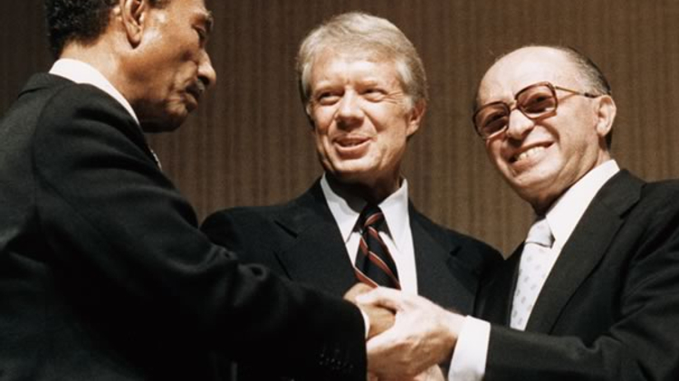 Presidents Anwar Sadat (R) and Jimmy Carter and Israeli PM Menachem Begin at signing of Israel-Egypt peace agreement