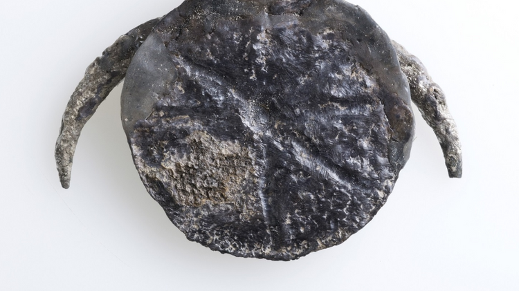 A medallion consisting of a silver disc with an engraving of an eight-pointed star was found at Tel Gezer