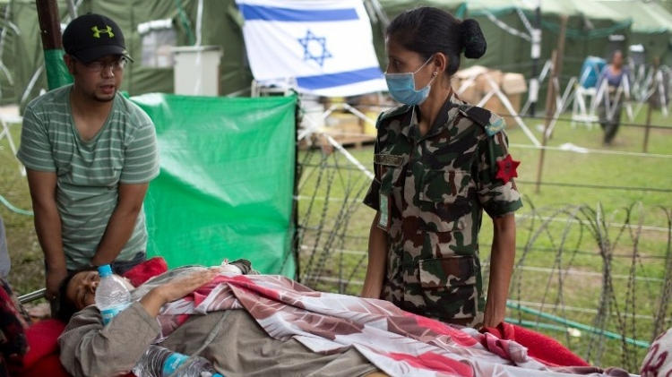 An injured Nepalese woman arrives on stretcher to be treated at the Israeli field hospital in Kathmandu on May 1, 2015, following a 7.8 magnitude earthquake which struck the Himalayan nation on April 25