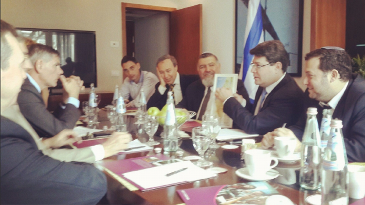 MK Ofir Akunis (holding map) meets with Flemish Interest delegates