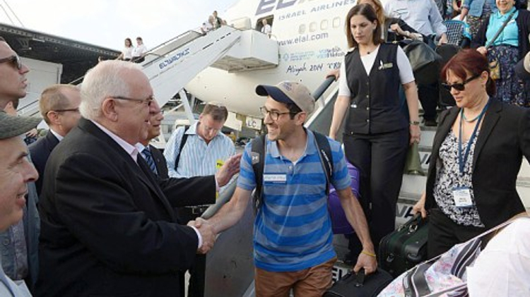 Israel's President Ruby Rivlin greets new Olim as they step off the plane