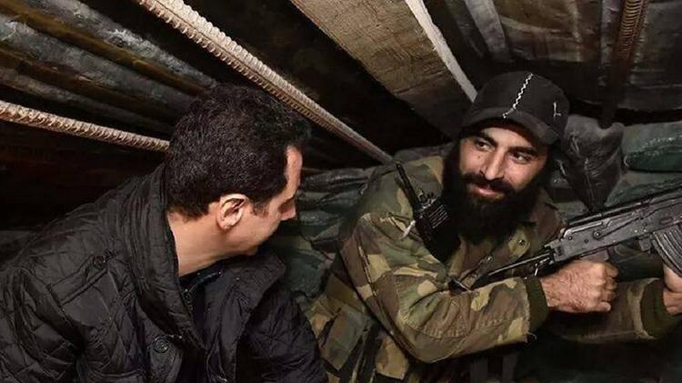 الرئيس السوري بشار الأسد يتفقد قواته في حي جوبر الدمشقي بمناسبة حلول رأس السنة الجديدة