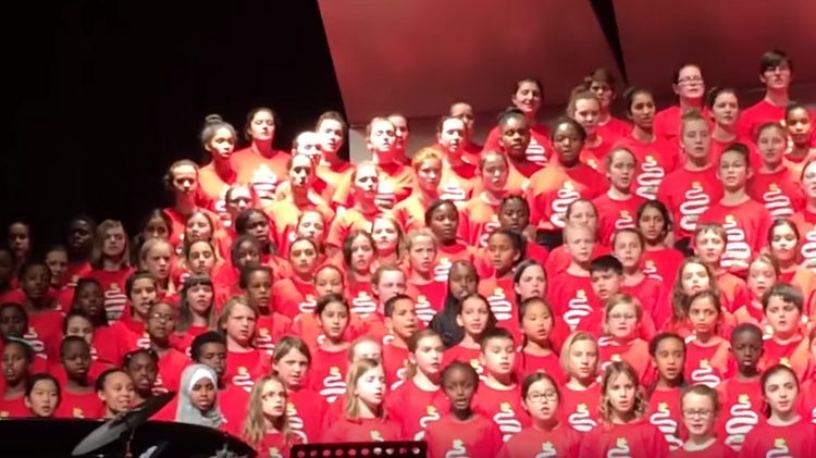 Canadian children welcome Syrian refugees with song sung to Mohamed when he sought refuge