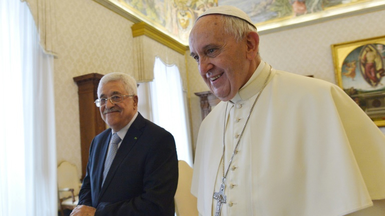 Pope Francis (R) walks along with Palestinian authority President Mahmud Abbas (L) during a private audience on May 16, 2015 in Vatican