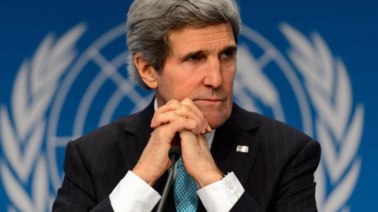US Secretary of State John Kerry gestures looks on during a press conference closing the Geneva II peace talks on January 22, 2014, in Montreux