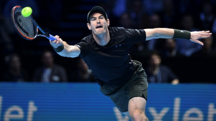 Andy Murray hits a return against Stan Wawrinka at the ATP World Tour Finals tennis tournament in London on November 18, 2016