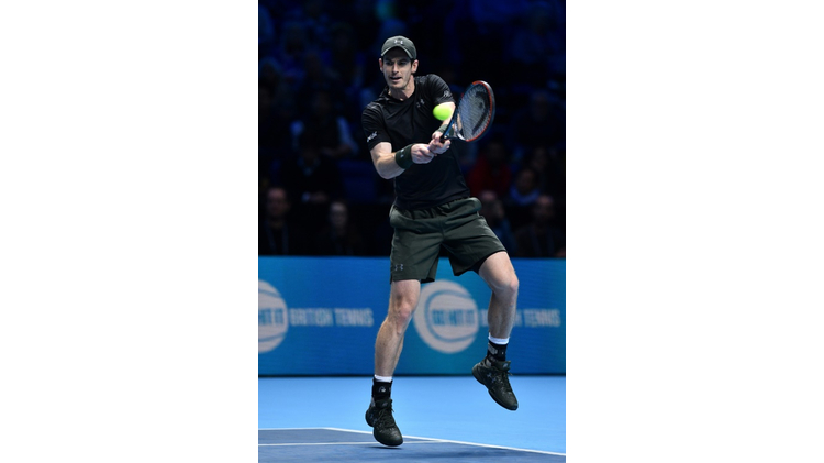 Britain's Andy Murray returns against Canada's Milos Raonic during their semi-final match at the ATP World Tour Finals tennis tournament in London on November 19, 2016
