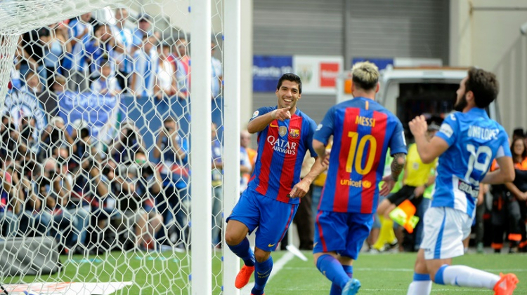 Luis Suarez (L) and Lionel Messi of Barcelona celebrate a goal during their Spanish league match against hosts Leganes on September 17, 2016