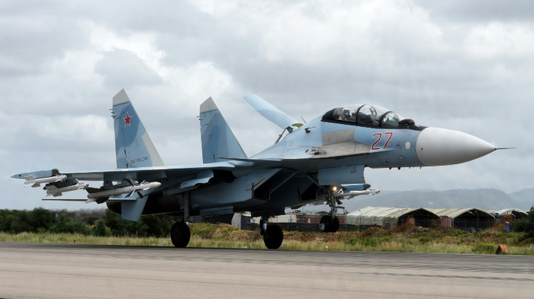 A Russian Sukhoi Su-35 bomber lands at the Russian Hmeimim military base in Latakia province, in the northwest of Syria