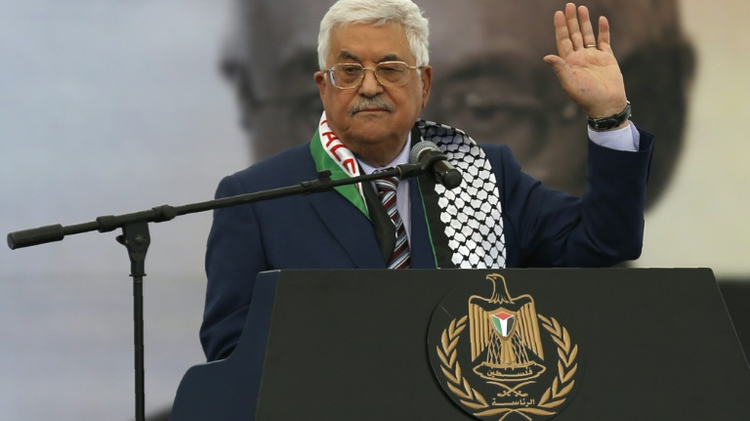 Palestinian president Mahmud Abbas gives a speech during a rally marking the 12th anniversary of the death of Yasser Arafat in Ramallah on November 10, 2016
