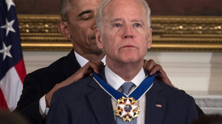 US President Barack Obama awards Vice President Joe Biden the Presidential Medal of Freedom during a tribute to Biden at the White House January 12, 2017