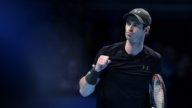 Britain's Andy Murray celebrates winning the first set against Switzerland's Stan Wawrinka during their round robin stage men's singles match on day six of the ATP World Tour Finals tennis tournament in London on November 18, 2016