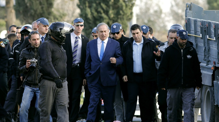 Israeli Prime Minister Benjamin Netanyahu (center) visits the site of a vehicle-ramming attack in Jerusalem, on January 8, 2017