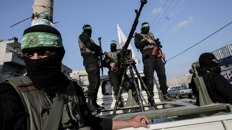Members of the Ezzedine al-Qassam Brigades, the military wing of the Palestinian Islamist movement Hamas, take part in a rally marking the 29th anniversary of the creation of the movement on December 16, 2016