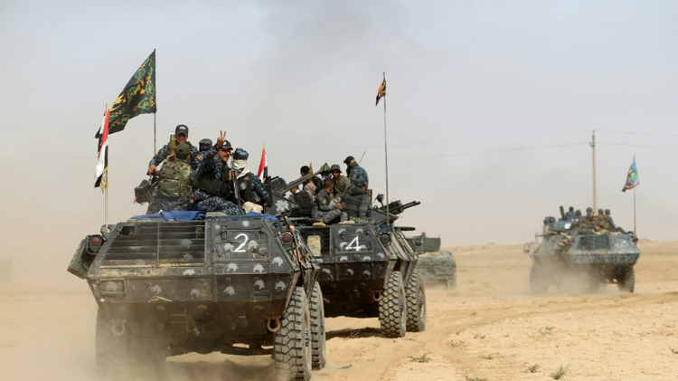 Iraqi forces deploy on October 17, 2016 in the area of al-Shura, some 45 kms south of Mosul