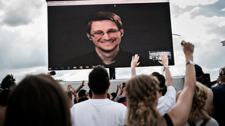 NSA whistleblower Edward Snowden is seen on a giant screen as he is interviewed by performance group The Yes Men live at the Roskilde Festival in Denmark on June 28, 2016