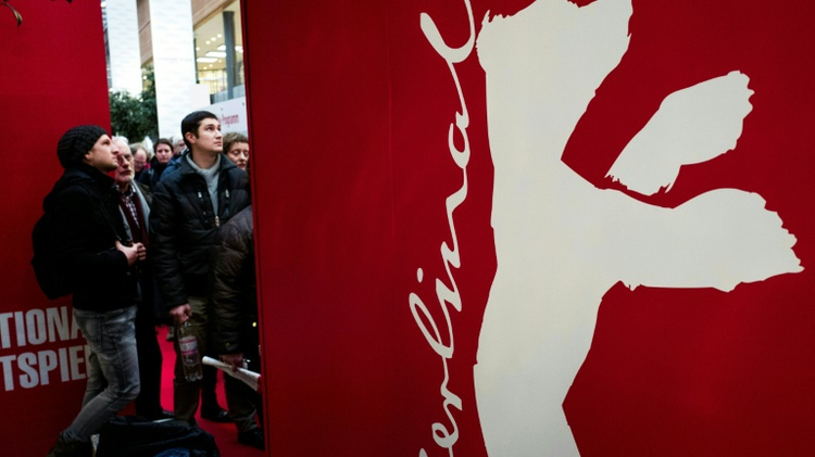 Spectators queue for tickets to the Berlinale film festival, February 8, 2016