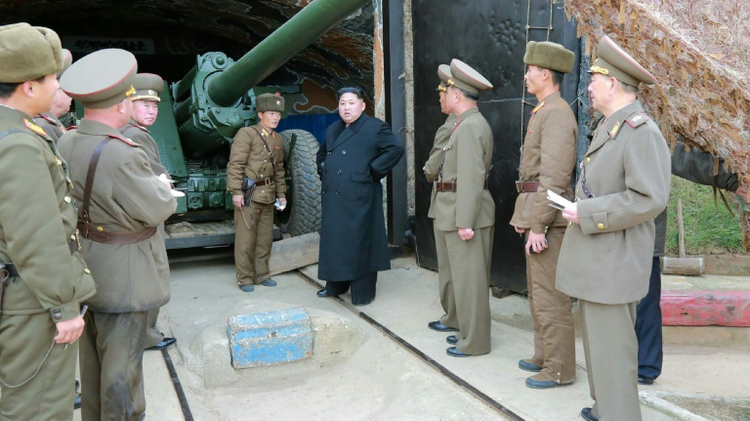 Undated photo released by North Korea's official Korean Central News Agency (KCNA)  shows North Korean leader Kim Jong-Un (C) at the defence detachment on Mahap Islet