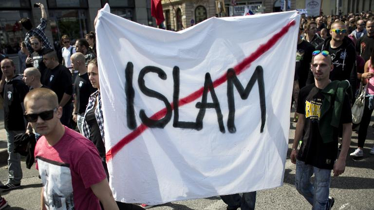 """Participants hold a banner during an anti-immigration rally organised by an initiative called """"Stop Islamisation of Europe"""" in Bratislava, Slovakia on June 20, 2015"""