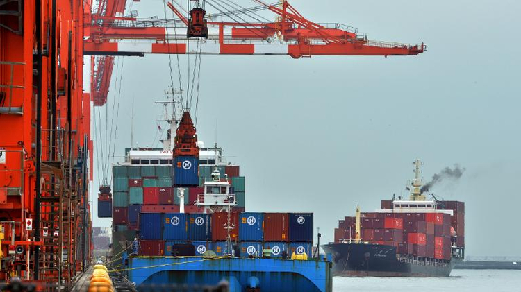 File photo: Shipping containers are unloaded from an international freighter at the international cargo terminal in Tokyo on October 21, 2013