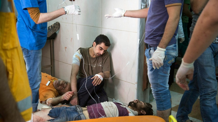 Aleppo hospital hit, army presses assault