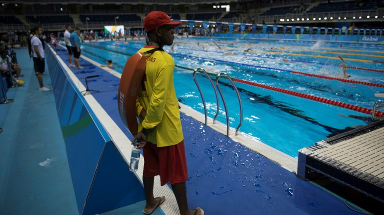 A Brazilian lifeguard watches swimmers at the Olympic pool in Rio de Janeiro, Brazil, on August 4, 2016