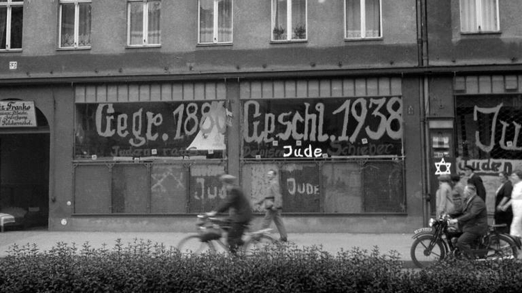 A Jewish-run store vandalised by Nazis and daubed with anti-Semitic graffiti in Germany, on November 10, 1938