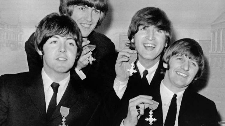 The Beatles after being decorated by Queen Elizabeth at Buckingham Palace in London on October 26, 1965