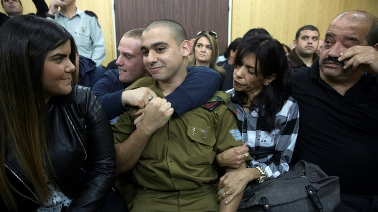 Israeli soldier Elor Azaria (C) had been on trial for manslaughter in a military court, with right-wing politicians defending him despite top army brass harshly condemning the killing