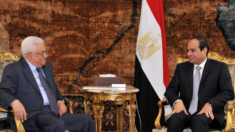 A picture released by the Egyptian Presidency on July 17, 2014, shows Egypt's President Abdel Fattah al-Sisi meeting with Palestinian president Mahmud Abbas in Cairo