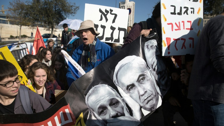 Israeli protesters in front of the Supreme Courtduring a hearing on natural gas deal in 2016