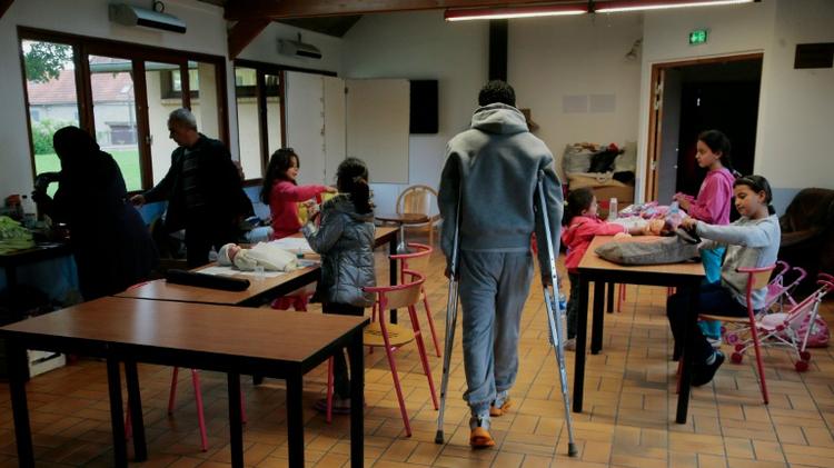 Des réfugiés dans un centre d'accueil à Cergy le 16 septembre 2015