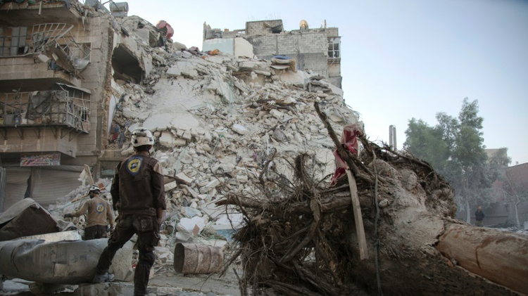 A member of the Syrian Civil Defence -- known as the White Helmets -- stands amid the rubble of a destroyed building in Aleppo, on October 17, 2016